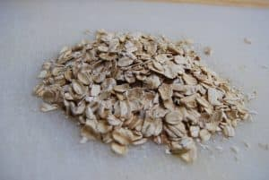 Close up of a bunch of oats on a white cutting board