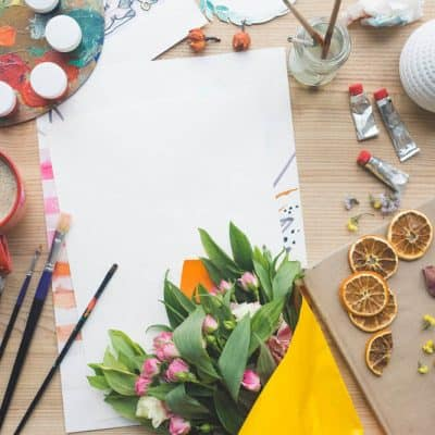 A Bouquet of Colorful Flowers, Paper, and Craft Supplies Artistically displayed on a table