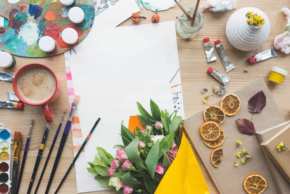 Craft Supplies, Paper, and Craft Supplies Artistically laid out on wooden table top
