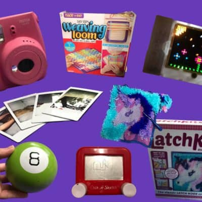 Retro Toys That Inspire Creativity - instax camera with developped filmed, Magic 8 Ball, Weaving Loom Kit Box, Mini Etch A Sketch, Unicorn Latch Hook Kit and Box, Lite Brite all on a purple background