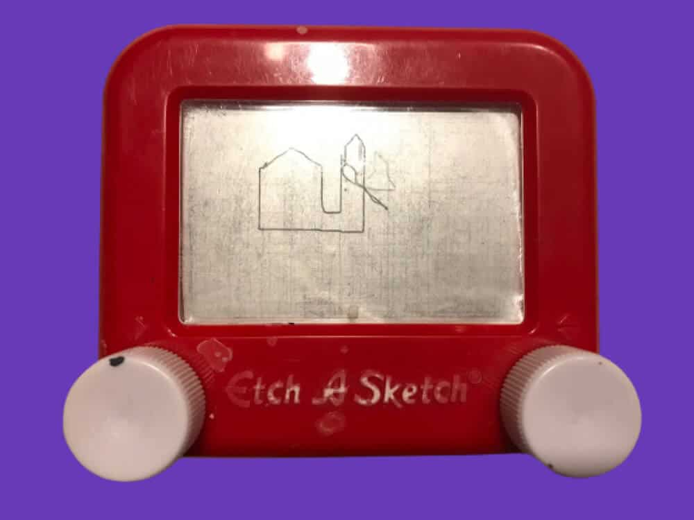 Mini Etch A Sketch Retro Toy on a Purple Background with Drawing of building on it