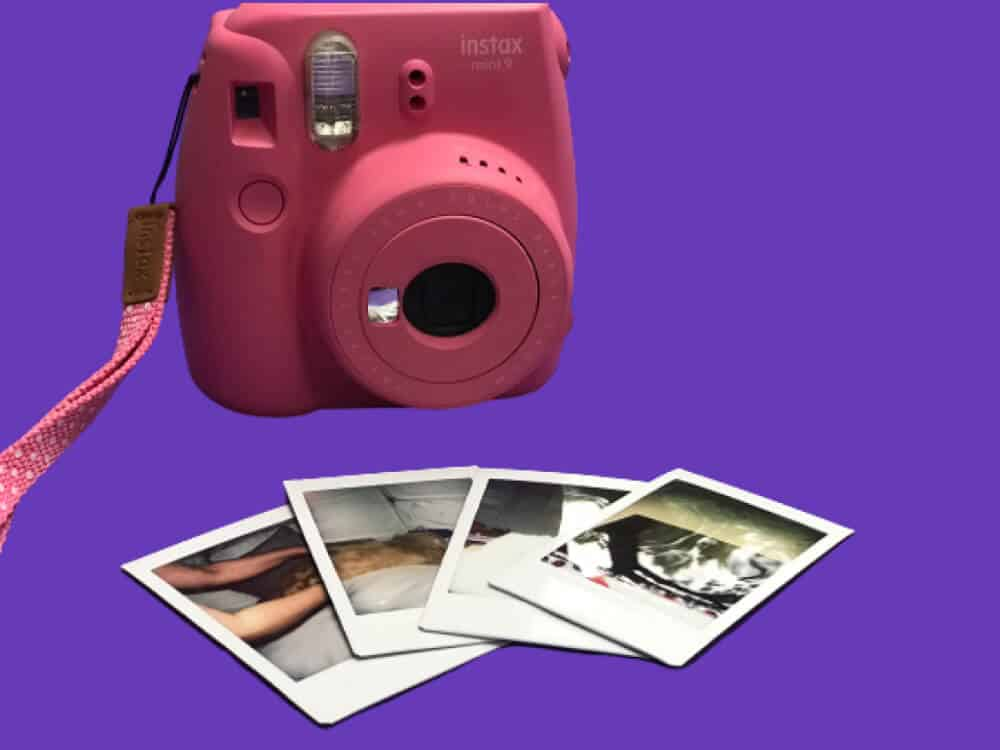 Retro Inspired Pink Instax mini 9 Camera with four developped pictures on a purple background