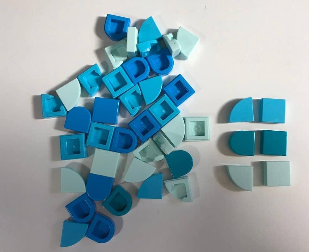 a pile of blue Lego Dots Pieces