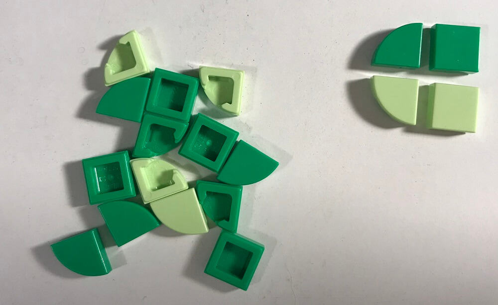 a pile of green Lego Dots Pieces