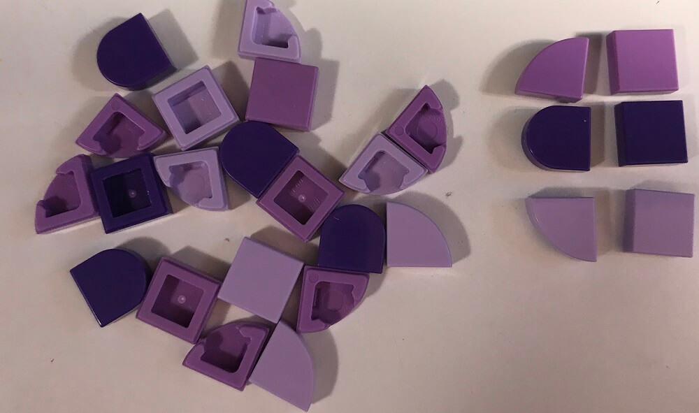 pile of purple Lego pieces for Lego Dots Bracelet Set