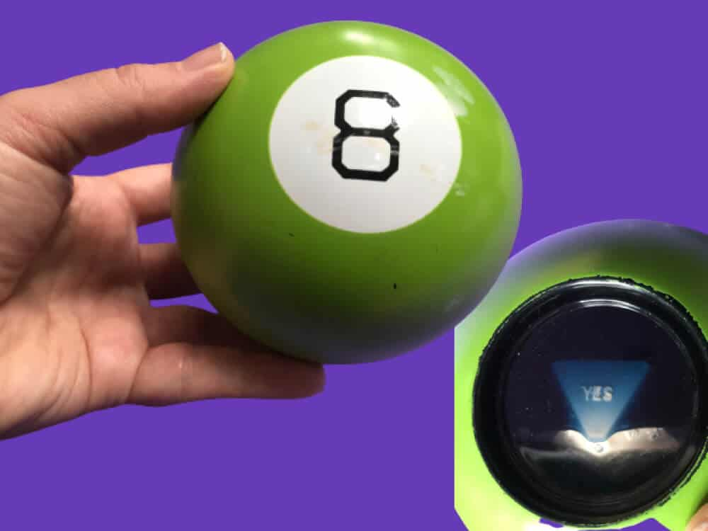 Retro Creative Toy Green Magic Eight Ball on a purple background
