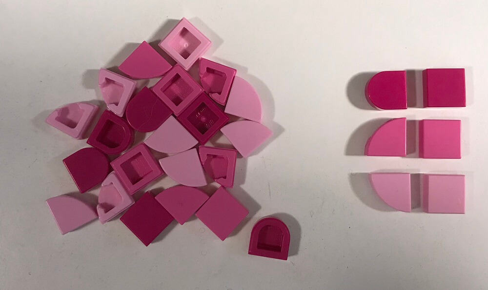 a pile of pink Lego Dots Pieces