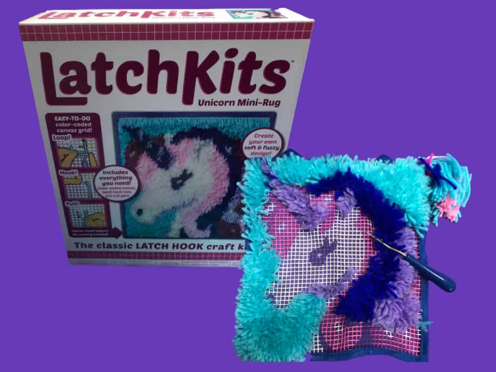 Retro Toy Unicorn Latch Kit Showing Box and Partially Completed Latch Kit with Hook on a Purple Background